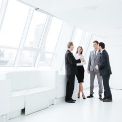 Full,Length,Portrait,Of,Business,Team,Stand,Near,The,Window